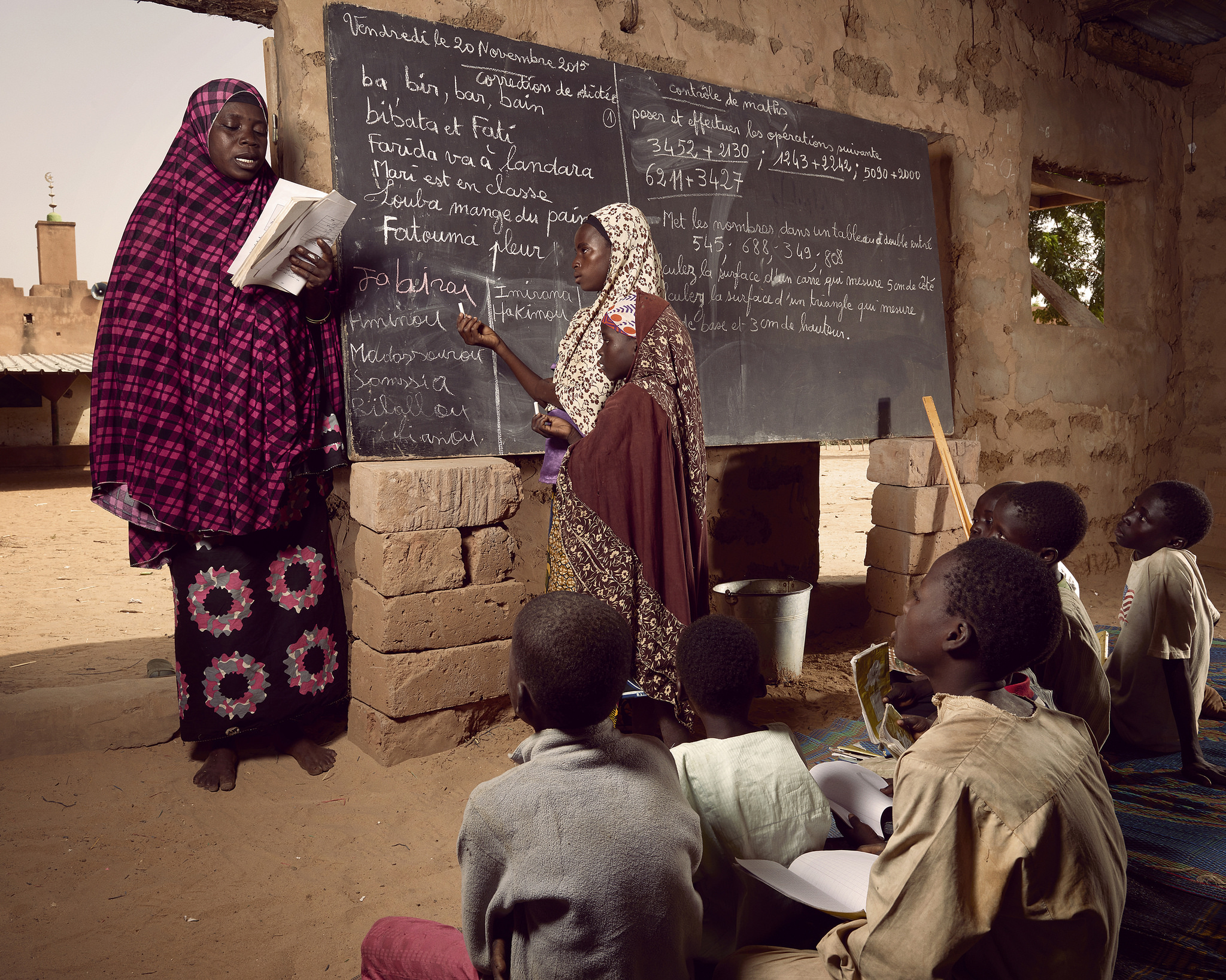 Children in the village of Guéchémé use a omen's prayer space to pursue their studies while a new school is being built, World Bank Photo Collection, Flickr