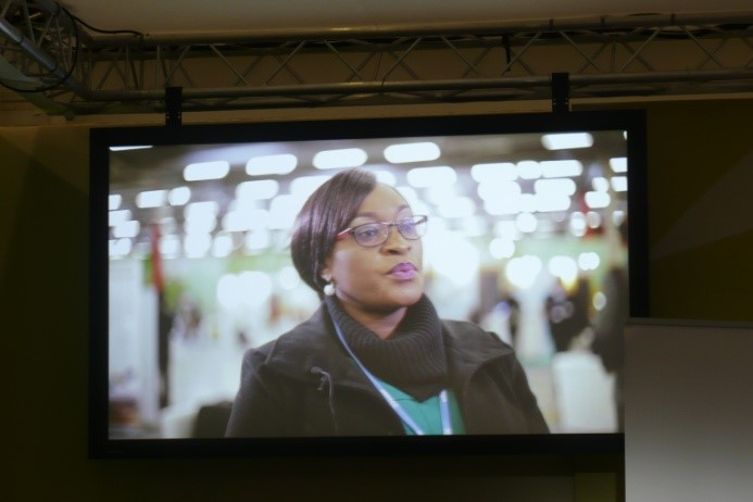 One of the screens showing the YCD video at COP21, which includes comments from Shamiso.