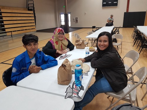 Ms. Saraswati with two other students at the Tribal Climate Camp in Eatonville, United States. /©UN CC:Learn